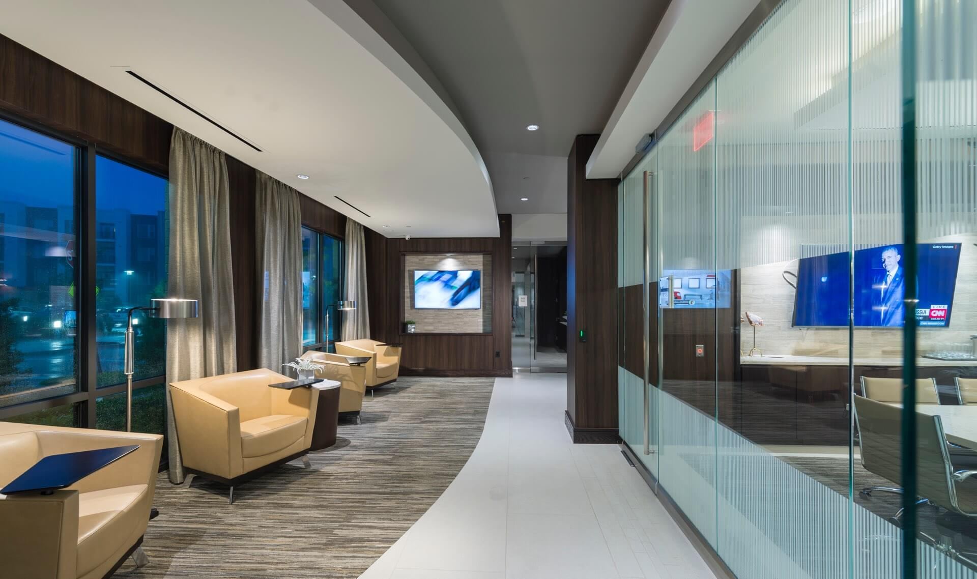 Resident forum with lounge seating & conference room with media console