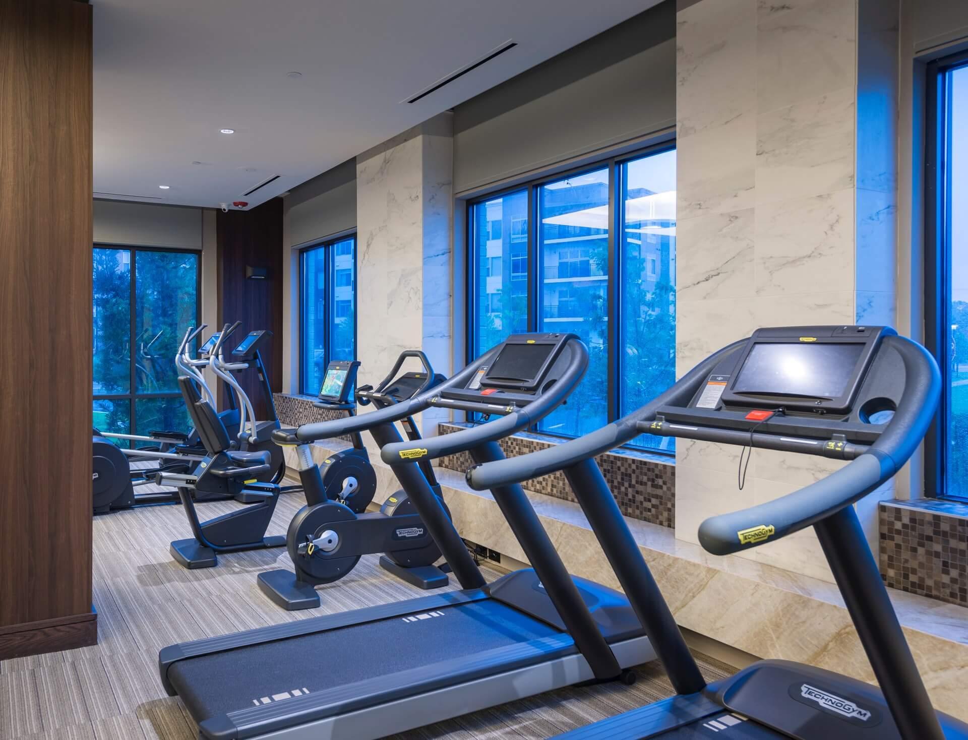 Fitness center with Peloton bikes & yoga room